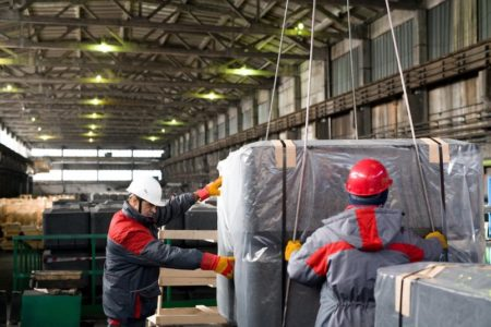 Movers Working at Plant