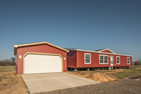 New manufactured home and stick built garage need finishing before owners can move in